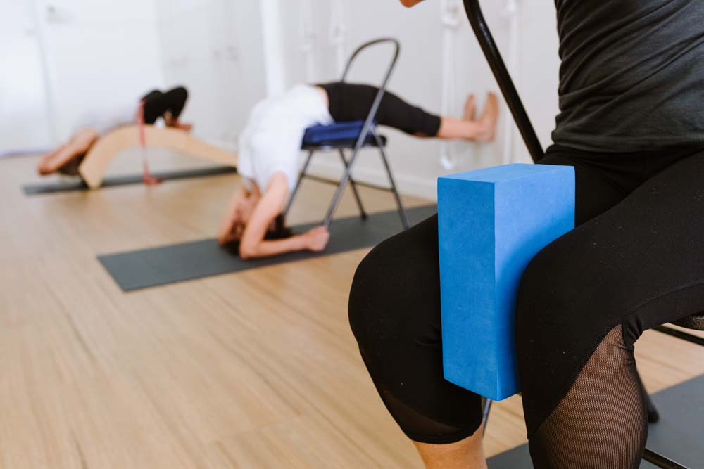 yoga students using props
